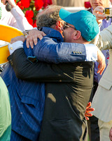 Ahmed Zayat, owner of Kentucky Derby (GI) winner American Pharoah, celebrates with regular exercise rider George Alvarez in the winners' circle.