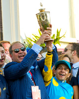 Ahmed Zayat, owner of Kentucky Derby (GI) winner American Pharoah, celebrates with regular rider Victor Espinoza in the winners' circle.
