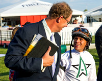 WinStar Farms CEO Elliott Walden congratulates winning rider Javier Castellano after winning the Pimlico Special (GIII) with Commissioner at Pimlico Race Course in Baltimore, Maryland.