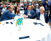 Ahmed Zayat and Bob Baffert celebrate drawing the five gate for the Belmont Stakes at the Belmont Stakes Post Draw in Rockefeller Center in Manhattan, New York.