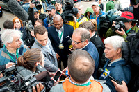 Ahmed Zayat and Justin Zayat are surrounded by media just before the arrival of Kentucky Derby (GI) and Preakness (GI) winner American Pharoah to Belmont Park in Elmont, New York.