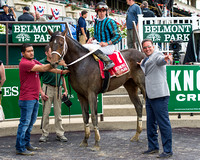 Cocked and Loaded, Irad Ortiz, Jr. aboard, trained by Larry Rivelli, in the winners' circle after winning the Tremont Stakes at Belmont Park in Elmont, New York.