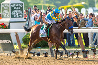 American Pharoah with Victor Espinoza up, wins the 147th Belmont Stakes (GI) and becomes the 12th Triple Crown winner at Belmont Park in Elmont, New York.