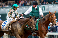Edgar Prado celebrates with a fist bump to an outrider at Keeneland Race Course after winning the Pin Oak Valley View Stakes(GIII) with Tiger Ride on closing day of the Fall Meet.