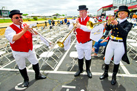Sam Grossman, Ryan Resky, Bethann Dixon play for the fans on Black Eyed Susan Day at Pimlico Race Course in Baltimore, Maryland.