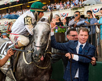 Bobby Flay walks Creator down Victory Lane after winning the Grade I Belmont Stakes at Belmont Park in Elmont, New York.