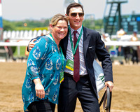 Assistant Trainers Leana Willaford and Rodolphe Brissette are all smiles after Carina Mia, with Julien Leparoux up and trained by Bill Mott, wins the Grade I Acorn Stakes at Belmont Park in Elmont, Ne