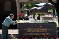 The traditional blanket of carnations is attached to the Secretariat statue in the Belmont Park paddock.