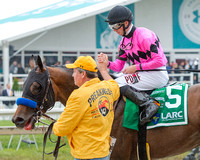 Florent Geroux celebrates with groom Roberto Luna after winning the Latin American Racing Channel Sir Barton Stakes with American Freedom at Pimlico Race Course in Baltimore, Maryland.