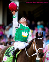 Javier Castellano celebrates after winning the 142nd running of the Kentucky Oaks at Churchill Downs in Louisville, Kentucky.