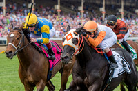 Ben's Cat (right), with Trevor McCarthy aboard, wins the Jim McKay Turf Sprint stakes for the fifth time in six tries for trainer King Leatherbury at Pimlico Race Course in Baltimore, Maryland.