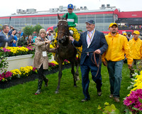 Owner Matt Bryan walks Preakness winner Exaggerator into the winners circle at Pimlico Race Course in Baltimore, Maryland.