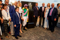 Dana Barnes, Bob Baffert, Bode Baffert, Jill Baffert and Mike Smith along with Garrett O'Rourke, Dr. John Chandler, Belinda Stronach and Frank Stronach with the Pegasus World Cup trophy in the Gulfstr