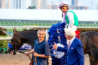Trainer Bob Baffert gives a thumbs up to groom Eduardo Luna after Arrogate and jockey Mike Smith won the 2017 Pegasus World Cup Invitational at Gulfstream Park.