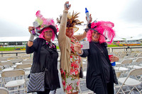Hats and fashions on Black Eyed Susan day at Pimlico Race Course in Baltimore, Maryland.