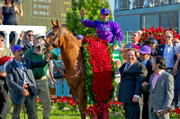 California Chrome and rider Victor Espinoza in the winner's circle after winning the 140th Kentucky Derby.