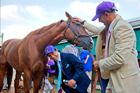 Jockey Victor Espinoza with California Chrome, as exercise rider Willie Delgado looks on, after winning the 139th Preakness Stakes at Pimlico Race Course in Baltimore, Maryland.