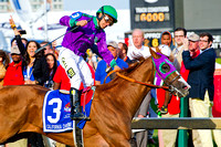 Victor Espinoza celebrates winning the 139th Preakness Stakes with California Chrome at Pimlico Race Course in Baltimore, Maryland.