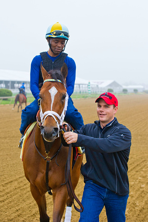 Norman Casse, assistant trainer, smiles as he walks Illinois Derby winner and Preakness Contender Dynamic Impact back to the stable at Pimlico Race Course in Baltimore, Maryland.