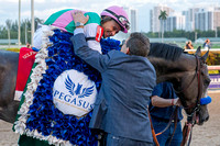 Assistant trainer Jimmy Barnes hugs rider Mike Smith after winning the 2017 Pegasus World Cup Invitational at Gulfstream Park.