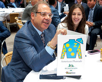 Ahmed Zayat poses with the American Pharoah placard at the Belmont Stakes Post Draw in Rockefeller Center in Manhattan, New York.