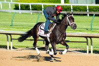 Eskenformoney, with exercise rider Ezequiel Perez, galloped a mile and one half in preparation for the Kentucky Oaks.