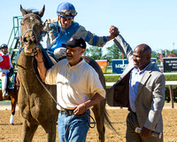 Manuel Franco and trainer Charlton Baker celebrate winning the Grade II True North Stakes with Joking at Belmont Park in Elmont, New York.