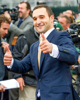 "Justin Zayat gives the ""thumbs up"" after Triple Crown winner American Pharoah, ridden by Victor Espinoza, won the Breeders' Cup Classic (GI) and became the first ""Grand Slam"" champion."