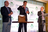 Stakes Coordinator Andrew Byrnes (left), Assistant Racing Secretary Sean Pearl (center), and Track Announcer Larry Collmus (right), draw the Belmont Stakes contender post positions at the Belmont Stak