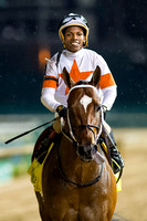 Cinco Charlie, Ricardo Santana Jr. up, wins the William Walker Stakes on Opening Night of the 2015 Spring Churchill Downs meet.