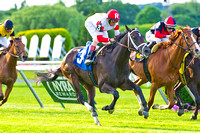 Charming Kitten with John Velazquez aboard wins the first Belmont Gold Cup Invitational at Belmont Park in New York.