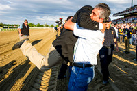 Assistant Trainer Jimmy Barnes gets hugged by groom Eduardo Garcia after American Pharoah wins the 147th Belmont Stakes (GI) and becomes the 12th horse to win the Triple Crown.