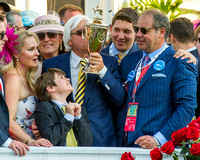 Bob Baffert, trainer of Kentucky Derby (GI) winner American Pharoah, celebrates with owner Ahmed Zayat, wife Jill, and son Bode in the winners' circle.
