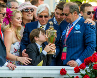 Bode Baffert, son of Bob Baffert, trainer Kentucky Derby (GI) winner American Pharoah, celebrates with owner Ahmed Zayat, and wife in the winners' circle.