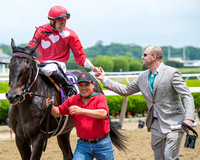 Francisco Torres, aboard Channel Marker, is congratulated by trainer Phillip Bauer after winning the Jaipur Invitational (GIII) at Belmont Park in Elmont, New York.