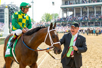 Owner Jerry Crawdford smiles at his Finnigan's Wake, with Victor Espinoza aboard, after winning the Woodford Reserve Turf Classic (GI) at Churchill Downs in Louisville, Kentucky.