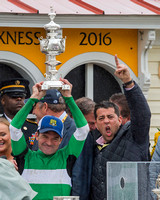 Preakness winning Jockey Kent Desormeaux (left) and co-owner Sol Kumin (right) hoist the trophy at Pimlico Race Course in Baltimore, Maryland.